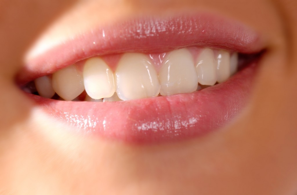 close up of smiling womans mouth and teeth