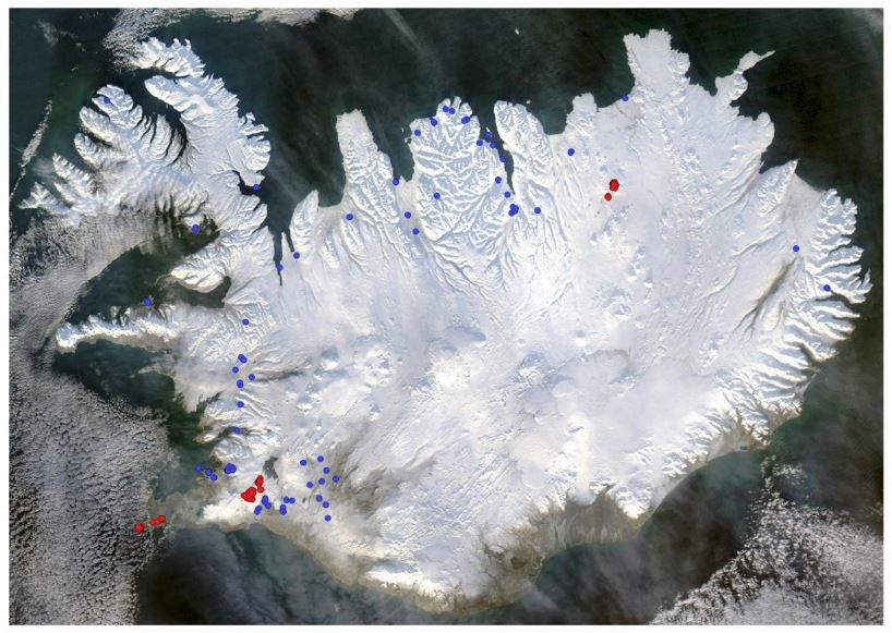 Figure 1: Satellite image of Iceland in winter time illustrating geothermal production wells in operation in year 2014 for geothermal power plants (red) and wells operated by heat utilities for distribution of heat. Over 100 production wells operated by small auto-producers are excluded.