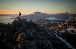 a-hiker-on-ukkusissaq-store-malene-in-the-midnight-sun-overlooking-ser